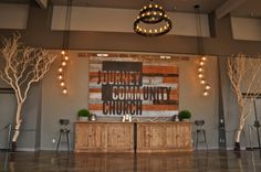the reclaimed wood sign with the church logo & name. Journey - A Church Lobby - Designed Interiors Church Lobby, Church Foyer, Church Interior Design, Church Stage Design, Church Welcome Center, Church Ministry, Ministry Ideas, Youth Ministry, Modern Church