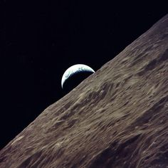 Earth rises above the moon's Ritz Crater in a view captured on Dec. 14, 1972, by Apollo 17's Ronald Evans.