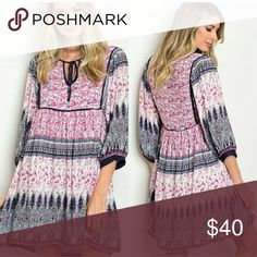"""💙Boho dress in navy blue and hot pink. 💕 Rayon blend with lining from waist down. Very light and flowing with swing bottom.   Small}  16"""" waist,  18"""" bust,  33"""" length Med}  18"""" waist,  19"""" bust,  35"""" length  Large} 19"""" waist,  20"""" bust,  36"""" length  Very trendy!  Super cute Measurements all laid flat Model is 5'1"""" and 100 lbs wearing a small. BUNDLE PRICE ~$34.20 entro Dresses Midi"""