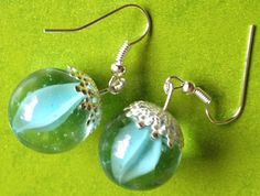 Frozen Elsa inspired earrings made with vintage blue marbles great for cosplay, Christmas or fancy dress Blue frozen vintage marble dangle drop earrings by VINTAGEnKITSCH