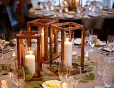 Make your own wedding table decor with beautiful DIY wood lantern centerpieces. Perfect for any event - holiday party, special celebration - and super easy to construct.