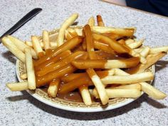 French fries and gravy - This reminds me of growing up in the U.P. eating at Bucks restaurant with my mom..