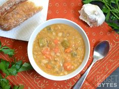 This Slow Cooker White Bean Soup practically makes itself! Just throw everything into the pot and press go to end up with a thick, flavorful, vegan soup. BudgetBytes.com eat