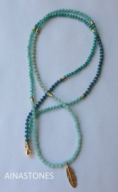 Items similar to Aqua tribal necklace made with semi-precious stones (agate et ammonite) and plume pendant on Etsy