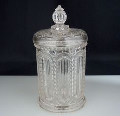 """EAPG Wisconsin Pickle / Jam Glass Jar   Antique pressed glass jar in the Wisconsin pattern. It stands 6.25"""" in total height and measures 3 3/8"""" in diameter. There are two small chips right below the finial, no damage found.    SOLD $39.99"""