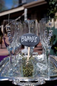 Champagne glasses were decorated with sprigs of lavender. | Photo by Jill Lauren Photography