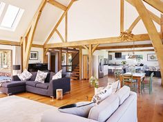 Beautiful high ceilings with oak trusses makes this sitting room feel large and airy but also welcoming. #sitting #room #large #truss #oak #oakframe #frame # welshoakframe  #wood #wooden #greenoak