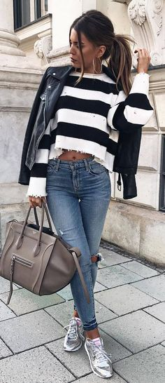 trendy outfit idea : moto jacket + stripped sweater + bag + rips + silver sneakers #omgoutfitideas #styleoftheday #womensfashion