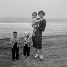 My mom and the three oldest Evans children on a trip to California. I love my older sister Nancy's and my matching clothes. What was your favorite family vacation as a child?