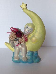 Angel asleep on the moon by emyliastone on Etsy, $17.99
