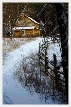 Cabin in the woods with first snow
