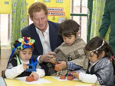 Prince Harry takes part in the kids games as he visits kindergarten of indigenous children a on June 27, 2014 in Santiago, Chile.