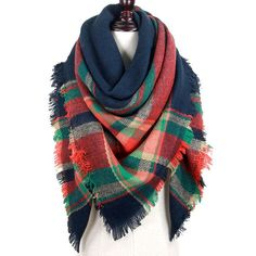 This blanket scarf could be our favorite, although it's so hard to pick! Throw this over a jacket, or wear around the house to keep warm and cozy. The beautiful navy, orange, and green go with so many