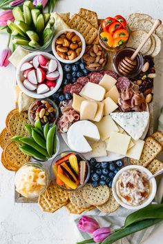 This budget friendly cheese board is made with inexpensive ingredients from Aldi! If you're looking for diy recipes and ideas for appetizers for a party or holiday parties like new years eve or Christmas, or Thanksgiving, try this display!