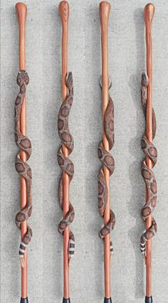 A great conversation piece on hikes or in the home, this hand-carved rattlesnake walking stick is carved from one solid piece of wood and stands