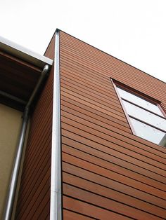 Wood Siding with Metal Flashing and Joints