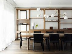 wood dining table and lindsey adelman brass lighting fixture
