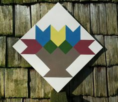 Check out this item in my Etsy shop https://www.etsy.com/listing/226444411/flower-basket-barn-quilt-square