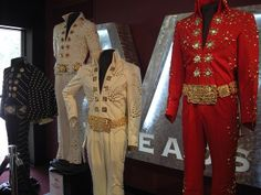 Some of the many jumpsuits Elvis wore during the 70's. On the far left is the Black Butterfly jumpsuit & cape, then the White Pinwheel jumpsuit from the film Elvis On Tour, then the Adonis jumpsuit from Madison Square Garden, and then, the Burning Love jumpsuit, also from Elvis On tour.