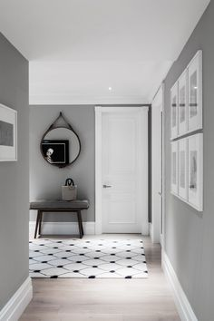 Love the white rug and grey walls