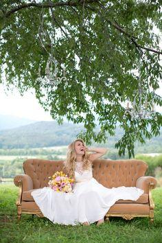 Gorgeous mountain venue, pretty bride, beautiful vintage sofa.