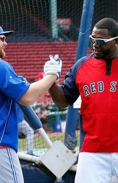 BOSTON, MA - JUNE 28: David Ortiz #34 of the Boston Red Sox shakes hands with Adam Lind #26 of the Toronto Blue Jays during batting practice at Fenway Park on June 28, 2013 in Boston, Massachusetts. (Photo by Jim Rogash/Getty Images)