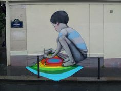 """French street artist Julien Malland, otherwise known as Seth Globepainter, creates colorful street art all around the world. His large scale murals most frequently depict children and are bursting with colors. Malland often collaborates with local artists, so his work tends to be contextual. The Paris-born artist has been active since the '90s. He released two books about his travels and street art. The last one is called """"Extramuros"""". It captures 3 years of his """"globepainting"""" when he was…"""
