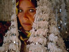 A young Berber bride is adorned for pre-wedding festivities in the High Atlas mountains.