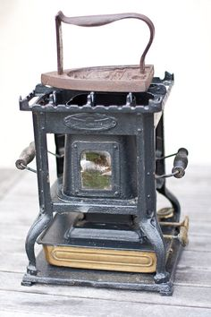 Ever curious as to how the old irons were heated? Antique French Sad Iron and Antique Kerosene Iron Heater.