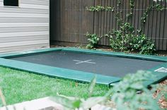 Sunken trampoline...love it!! I hate trampolines because I'm always afraid someone will fall and break their neck...if we ever get a trampoline this is the kind we will get...of course I still have to worry about them playing on other people's normal ones lol