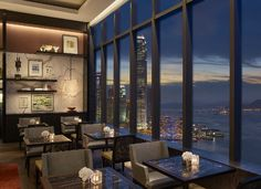 Specialty cocktails and hors d'oeuvres are paired with panoramic views of Victoria Harbor at the newly renovated Grand Club Lounge at Grand Hyatt Hong Kong.