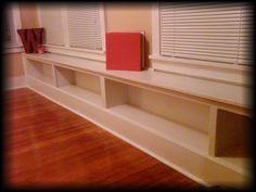 built in bookshelf/window bench   for dining room
