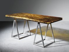 A RESIN AND BRUSHED STEEL TABLE BY MARIE-CLAUDE DE FOUQUIÈRES, CIRCA 1970