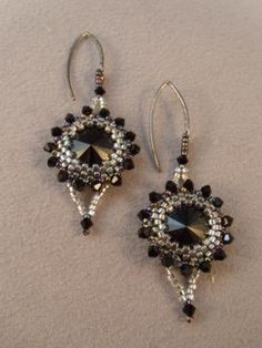 Glamour and Goth Earrings made with Swarovski crystal Rivolis in Jet Black.  Ear hooks by Ezel Findings.