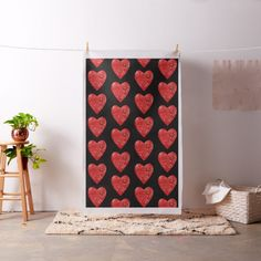 Spread Valentine's Day love all over your home with this sparkly red and black fabric by SPKCreative Stationery and Gifts featuring glittery red hearts with a hint of yellow and white.