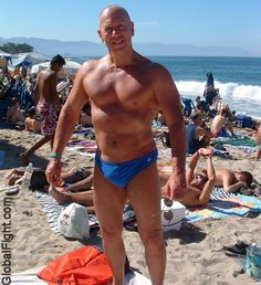 a gay beach muscular dad manly muscles