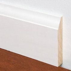 "$1.43/linear foot, 9/16"" x 5-1/4"" x 8' PFJ Primed Colonial Baseboard - 