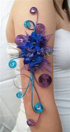 arm band corsages | Who says your corsage has to be on your wrist? These arm band corsages ...