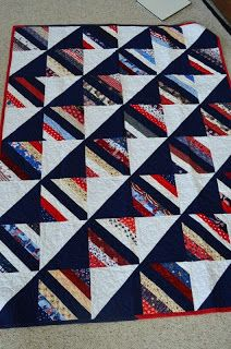 Alycia Quilts. String blocks alternate with black/white HSTs for a striking quilt. Like the layout of this quilt.