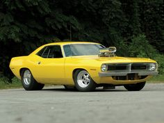 Another pic of the 70 Plymouth Barracuda. It's not right that a car should be this pretty.