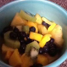 Fruit salad with honey lime cilantro dressing.