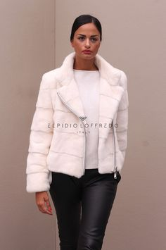 Female Mink Jacket with whole skins. Made in Italy. Skins Quality: KOPENHAGEN PLATINUM; Color: White; Closure: With Zip; Collar: Round – Rever; Lining: 100% Satin; Lining Color: Fantasy, Multicolor; Length: 58 cm;