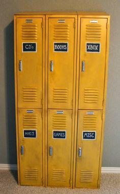 Antique lockers, painted with a glaze to tone down the bright yellow. Making it fit better in the vintage themed boys room. Chalkboard squares painted on each locker, labeling what is in each. http://Theraggedwren.blogspot.com