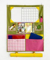Say goodbye to stacks of homework on the kitchen table and school books lost under couches and beds. With this clever caddy, you and your little one will be able to keep up with every assignment, project and school supply. Just hang this effective organizer over a bedroom or closet door and watch clutter magically disappear around the house and into this caddy that can carry it all. Voilà! And, for our next trick, we'll look into the future and see a straight-A r...