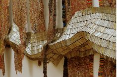 El Anatsui is a Ghanian sculptor who creates sumptuous textile installations. Using thousands of found objects, he sews together vibrant tapestries of scrap metal and bottle caps, creating fluidity out of shrapnel and tradition. Rather than rigidly controlling the construction and mounting of each piece, he prefers to let it drape naturally, ever-changing to reflect its new surroundings. Utterly magnificent.