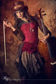 A little more steampunk Style...  I love the maroon color, modest corset, & elegant sleeves. (Just loose the hat!... But keep the cello!!! )