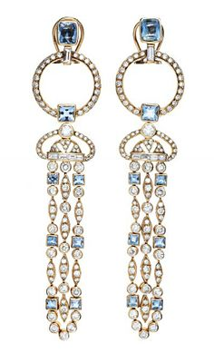 A PAIR OF DIAMOND, AQUAMARINE AND GOLD EAR PENDANTS   Set with approximately 154 circular-cut diamonds weighing approximately 5.25 - 5.75 carats total, and 10 baguette-cut diamonds weighing approximately 0.50 - 0.75 carats total, J/K color, VS-SI clarity, enhanced by a cushion and square-cut aquamarines, mounted in gold, for pierced ears, show signs of normal wear, overall condition good  4 x 7/8 ins.