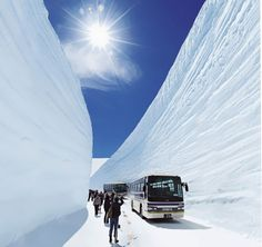 Sky-high snow walls dwarf a bus along the Tateyama Kurobe Alpine Route in Toyama, Japan Places To Travel, Travel Destinations, Places To Go, Beautiful World, Beautiful Places, Winter In Japan, Toyama, Kyushu, Historical Sites