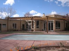 Custom residential steel pergola shade structure with natural rust finish.