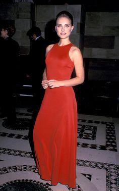 Natalie wore this stunning floor length red dress with racer-back elements adding to a its chic sophistication. Note again that she chooses few accessories to let the dress design shine.